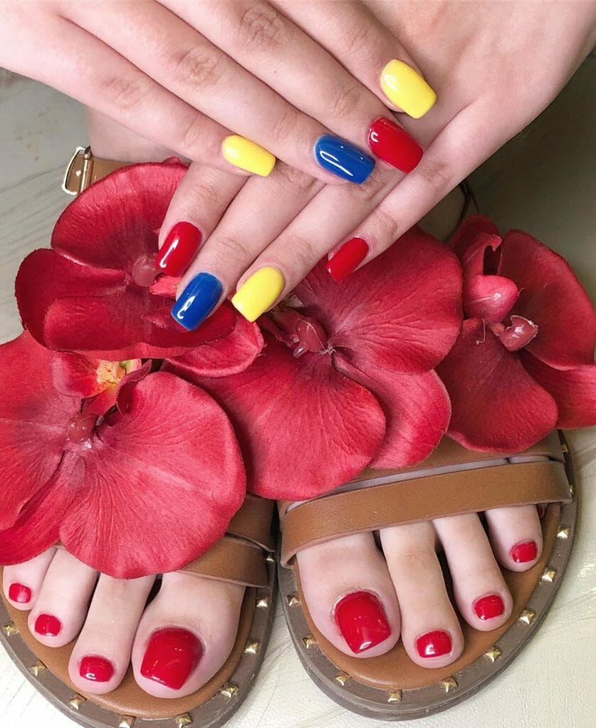 mixture of blue, red, and yellow nails
