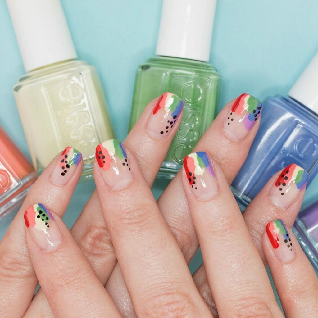 clear nail polish and bold stripe of colors with a few black dots