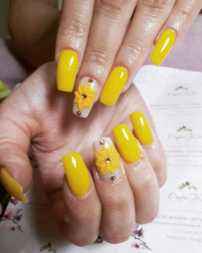 yellow nails with a small sunflower on one
