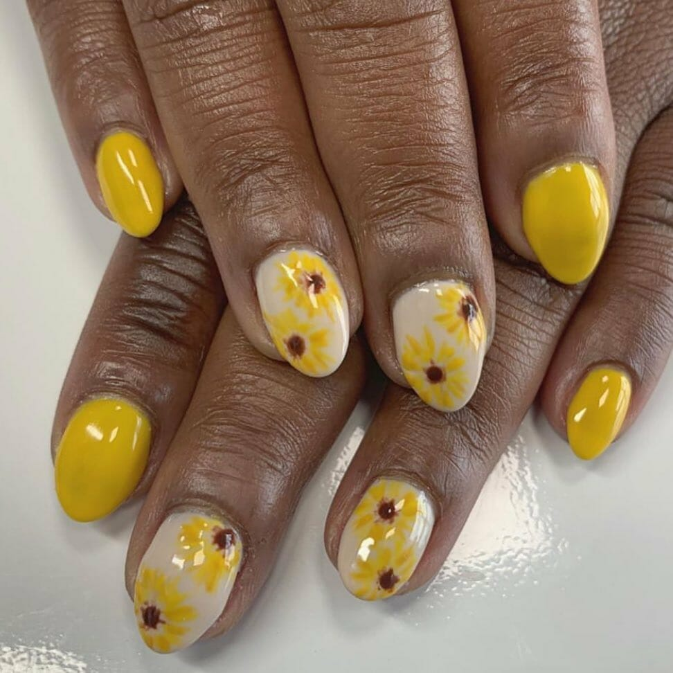 yellow and white nails with small sunflowers