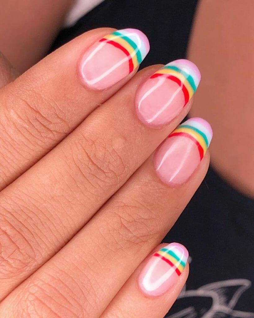 pink base and tips painted nail design