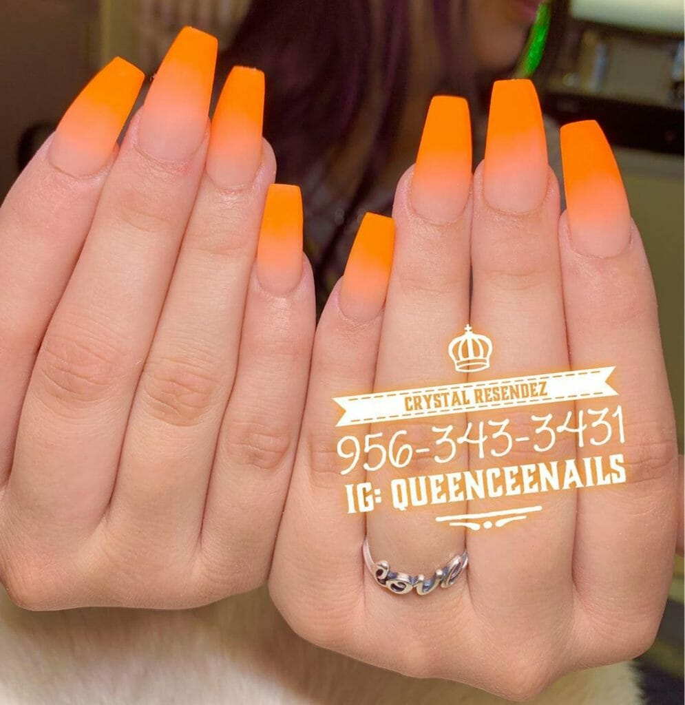 ballerina shaped nails with ombre orange colors